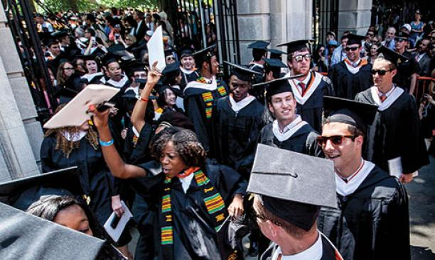 The Class of '14 exits jubilantly through FitzRandolph Gate at the conclusion of Commencement.