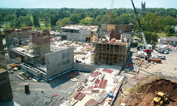 Concrete and steel have been rising for the three buildings on Alexander Street that will provide academic, rehearsal, and performance spaces for the music department, at left, and for the Lewis Center for the Arts.