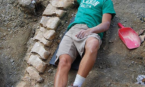 Evan Saitta '14 at the site of a fossil dig in Montana.