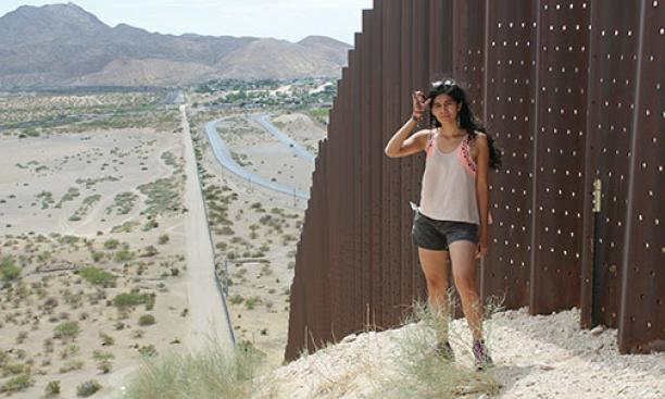 Yessica Martinez '15 along the U.S.-Mexico border last summer on a research trip for her thesis.