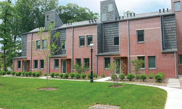 Lakeside's townhouses feature brick and tile exteriors and landscaping.
