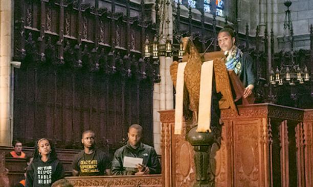 Students read a manifesto during the Chapel gathering; Naimah Hakim '16 is in the pulpit at upper right.