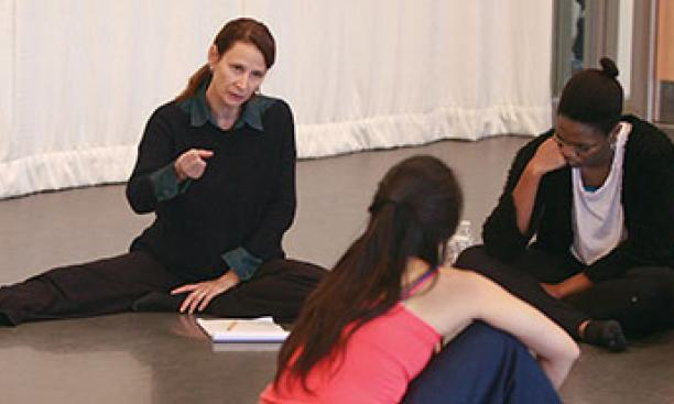 Susan Marshall works with students in an advanced choreography class.