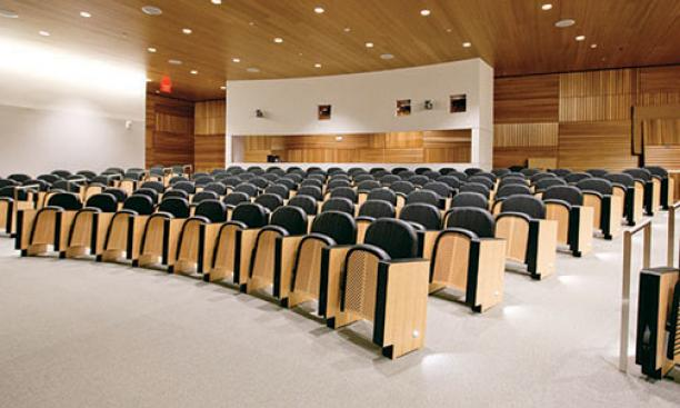 The 147-seat auditorium has oak paneling and custom seats made in Italy.