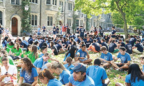 Following Opening Exercises and the Pre-rade, freshmen gathered for a barbecue on Alexander Beach.