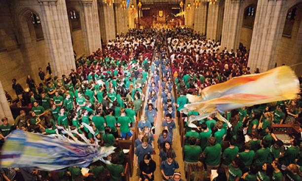 Students wearing the colors of their residential colleges fill the Chapel for Opening Exercises.