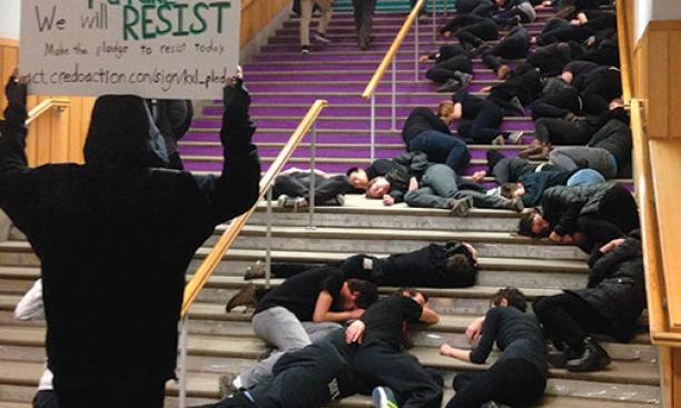 "Students stage a ""die-in"" at Frist Campus Center."