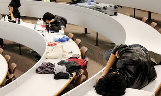 "The ""mental marathon"" of HackPrinceton takes its toll Saturday night on students in a Friend Center lecture hall."