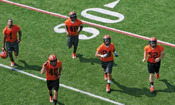 This year's football team (pictured at the first practice of the season) has a promising roster of returning players.