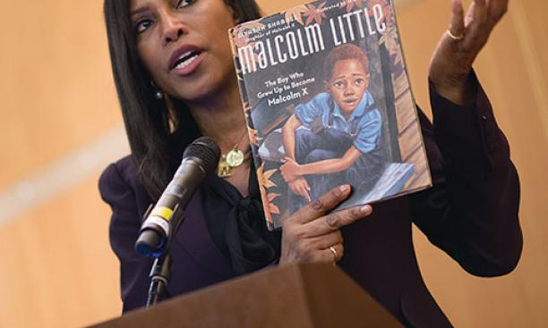 Ilyasah Shabazz with a book she wrote about her father, Malcolm X, as a child