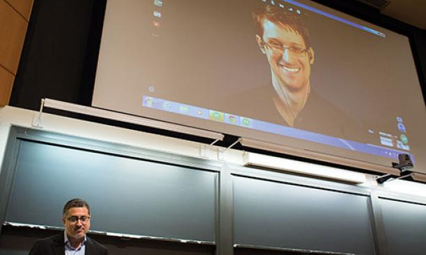 Journalist Bart Gellman '82, left, talks with Edward Snowden via video link.