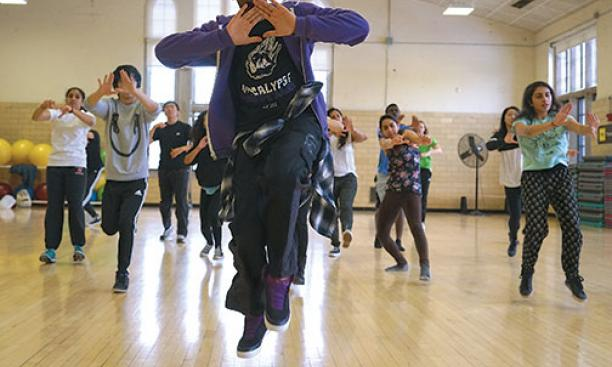 Don Wilson '15, of the Black Arts Company: Dance, leads students in a hip-hop routine.