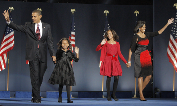 President-elect Barack Obama s'85, daughters Malia and Sasha, and first-lady-to-be Michelle Obama '85 wave to the crowd at an election night rally Nov. 4 in Chicago. A group of black Chicago-area alumni, friends of the Obamas and campaign fund-raisers