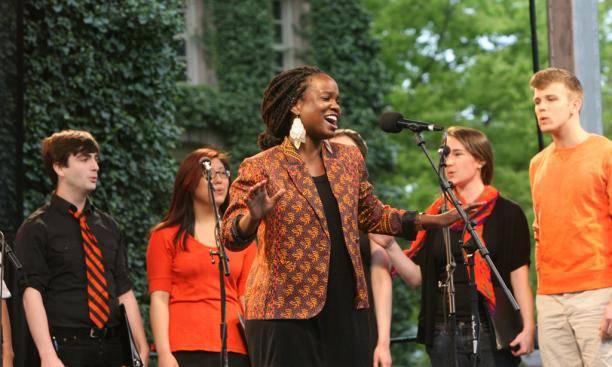 Tanyaradzwa Tawengwa '14, center, leads a performance by an a cappella group composed of members from each campus ensemble.
