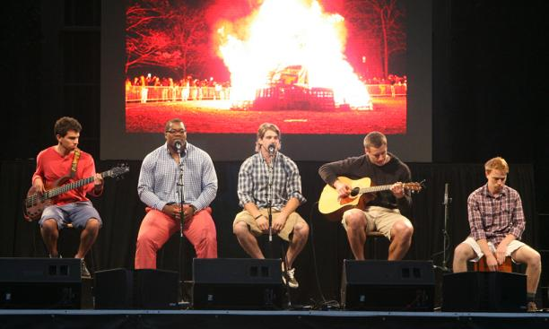 "Football stars Caraun Reid '13 and Roman Wilson '14, second and third from left, respectively, led a rendition of ""Ain't No Mountain High Enough,"" with an image of the Big Three bonfire in the background."