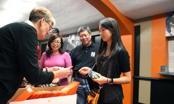 Stephanie Liu '15 receives her check-in package from Amy Campbell of the office of campus life.