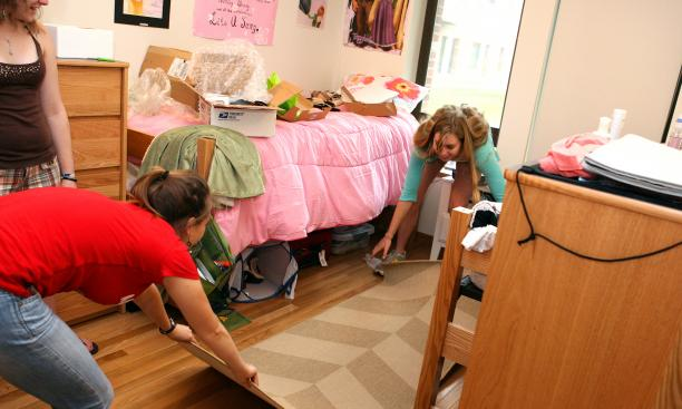 Daria Koren '15, left, and Silken Jones '15 set up their freshman dorm room.