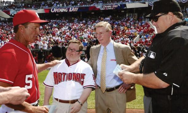 Baseball fan Jon Will, pictured with his father, gives the Washington Nationals' lineup card to umpires on Opening Day in 2010.