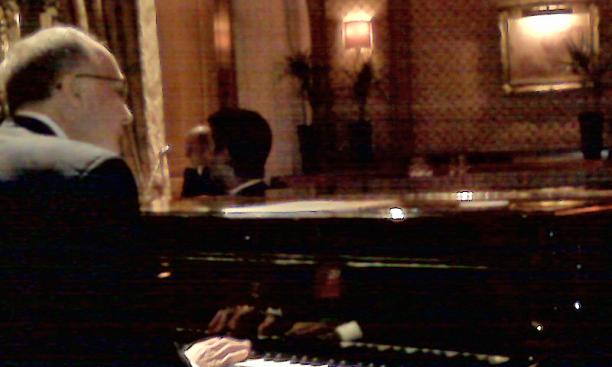 A cellphone photo captures Thomas Schiavoni '72's moment at the Steinway of the Bar Vendome in the Hotel Ritz in Paris.