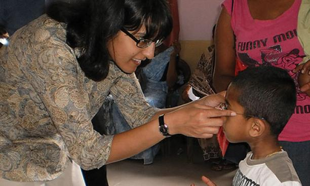 A nonprofit founded by Ashanthi Pereira Mathai '95, left, has provided prescription eyeglasses to 35,000 children and adults.