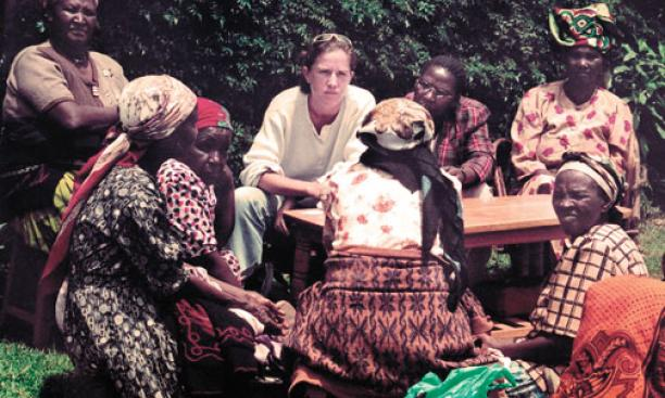 Caroline Elkins '91, center, in Kenya in 2003 with survivors of Britain's detention program.