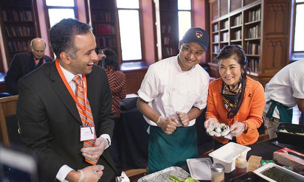 Chef Zar Ni, center, gave a lesson in making sushi to Karthick Ramakrishnan *02, left, and Jaime An-Wong s'75.