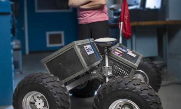 Laura Ray '84 *91 with Yeti, the robot she and her students built.