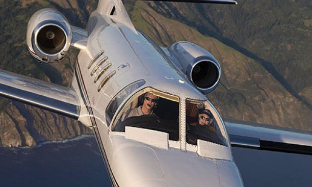 Howard Tobin '60 at the controls of his Citation Jet, which he uses to transport wounded veterans.