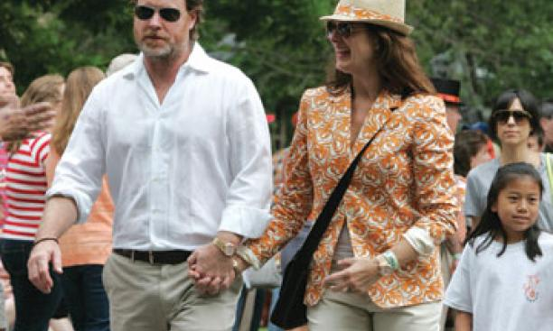 Actress Brooke Shields '87 and her husband, Chris Henchy, stroll down the P-rade route.