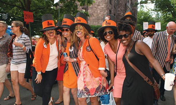 Graduate alumnae — all from the Woodrow Wilson School — model the APGA's hats. From left: Heather Lord *11, Jane Farrington *13, Cat Moody *12, Amber Greene *12, and Christina Henderson *12