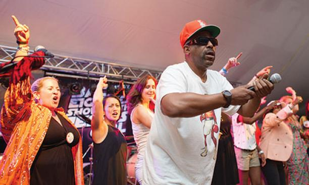 Rapper and actor Tone Lōc gets the crowd moving at the headquarters of the Class of 1990.