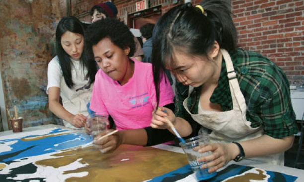 Students paint during a Princeton Atelier class on public murals.