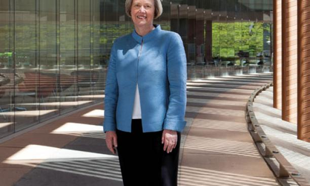 President Shirley M. Tilghman stands on newly named Tilghman Walk, which will link the Lewis Center for the Arts to science buildings housing genomics, neuroscience, and psychology.