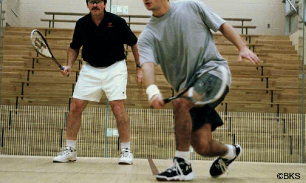 Men's squash coach Bob Callahan '77 retired in April after 32 seasons at Princeton. In 2005, Callahan, left, scrimmaged with top player Yasser El Halaby '06.
