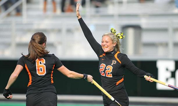 Maddie Copeland '16, right, celebrates with Sydney Kirby '15.