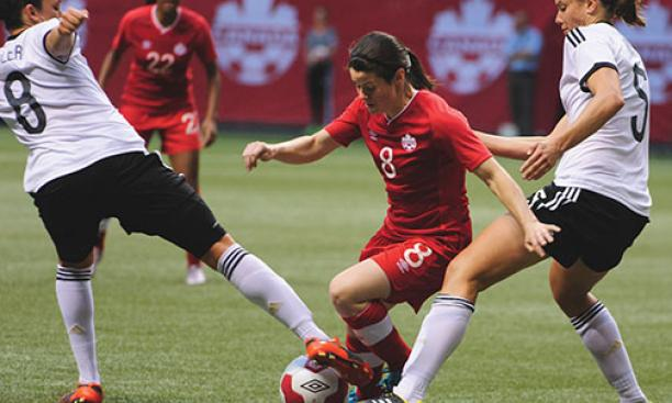 Diana Matheson '08, center, was named to Canada's World Cup roster in April.