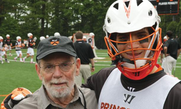 "Men's lacrosse faculty fellow John McPhee '53, with defenseman Rob Castelo '14, describes the sport as ""football, basketball, and ice hockey in an advanced state of evolution."""