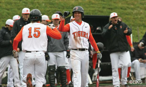 Much of the Tigers' success this season comes from its versatile roster. Players such as Matt Bowman '13 (at center facing camera, greeting Jonathan York '14) play more than one position.