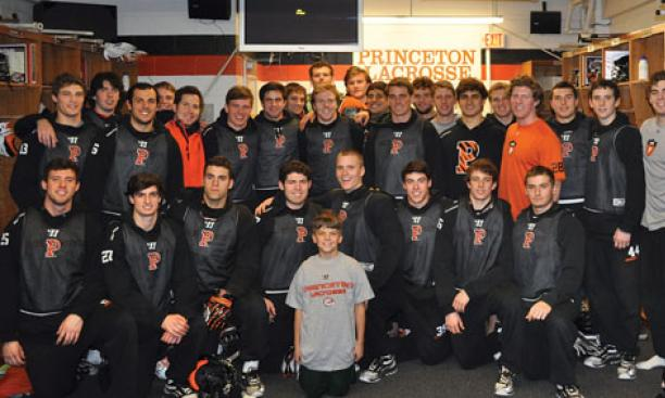 The lacrosse team with coach Chris Bates' son, Nicholas, whose mother died of cancer last year.
