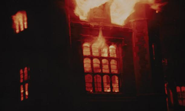 The University Gymnasium in flames.