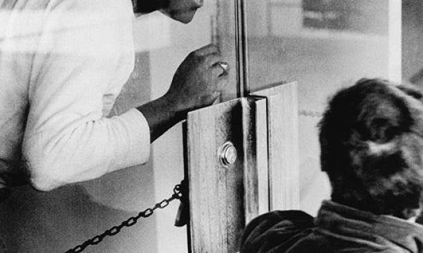 Brent Henry '69, a leader of the Association of Black Collegians and today a Princeton trustee, behind the chained door of the New South administration building.