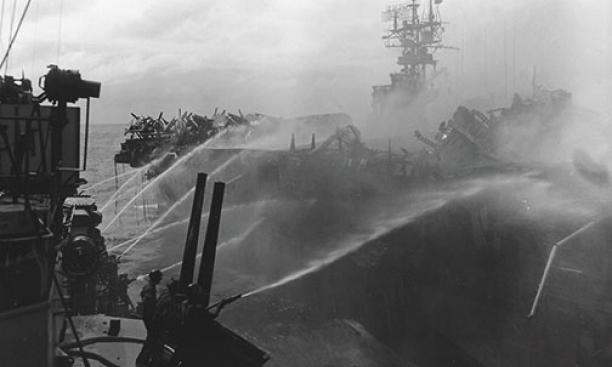 Alan Reed '40 died after boarding the USS Princeton, in flames, Oct. 24, 1944. He was assigned to the USS Birmingham, shown here fighting the fire.