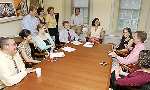 2003: Longtime admission dean Fred Hargadon retires, and new dean Janet Rapelye, pictured at head of table, arrives to take the post, becoming the first woman to hold the top admission job at Princeton. In the span of eight years, Rapelye and her colleagu