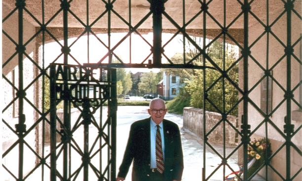 Alan W. Lukens '46 at the main entrance gate to the Dachau concentration camp.