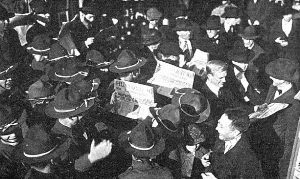 Students and soldiers read news of the end of World War I. (PAW Archives/Orren Jack Turner)