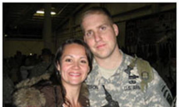 Lauren (Holuba) Nelson '04, shown with her husband Tom in February, was honored for her efforts supporting wives and families of men who served in Afghanistan and Iraq.