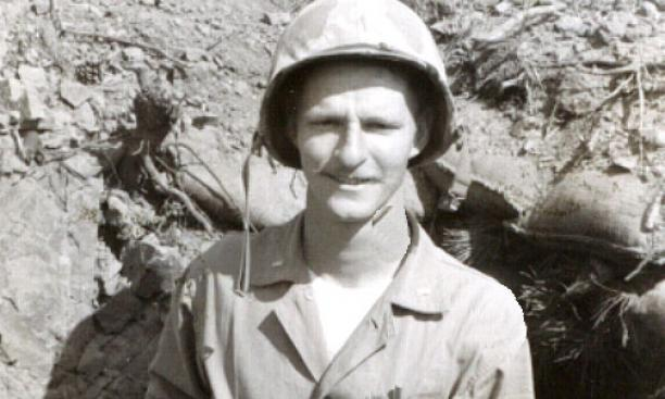 "Peter Clapper '49 in front of his ""hole"" in Korea. Clapper led a Marine infantry platoon and later suffered from post-traumatic stress disorder."