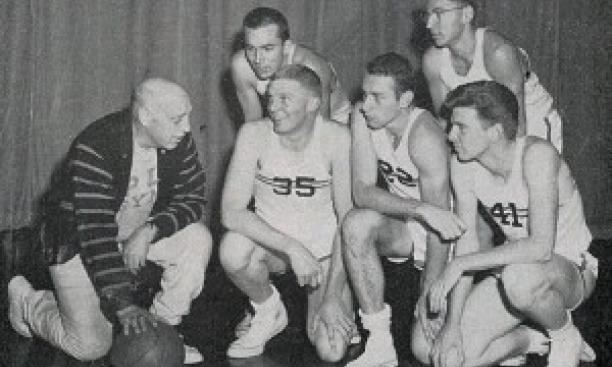 "Coach Cappy Cappon in 1958 with, from left, Jim Brangan '60, David Fulcomer '58, Carl Belz '59, Artie Klein '60, and Joseph Burns '59. Herman Belz '59 replaced Fulcomer in the 1958-59 ""iron five."" (Photo: PAW Archiv"