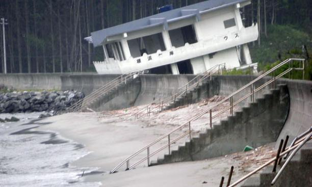 A bayfront guesthouse in Kamaishi destroyed by the tsunami, as was the concrete walkway.