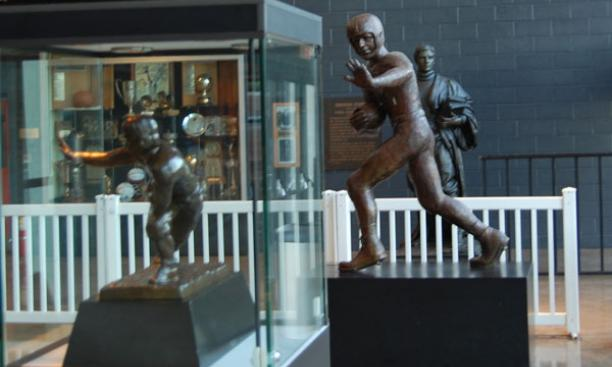 The lobby at Jadwin Gym includes, from left, the 1951 Heisman Trophy, a life-sized representation of Kazmaier in bronze, and a banner featuring his famous No. 42 jersey (next to Bill Bradley '65's jersey).